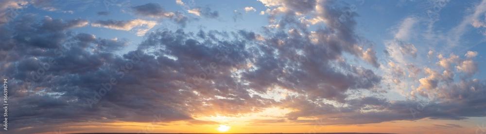 Fototapeta Storm clouds against a blue sky. Mystical sunset. Panorama. Tragic gloomy sky. Fantastic skies on the planet earth. Twilight, nightfall.
