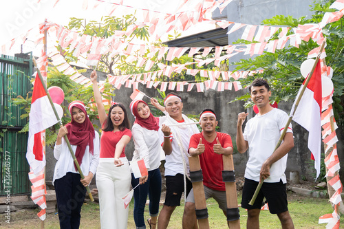 Asian boys and girls smile while carrying and flying the Indonesian flag each we Wallpaper Mural