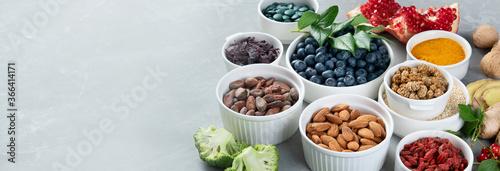Various superfoods on grey background. Fotobehang