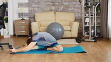 Man On Yoga Mat Stretching His...
