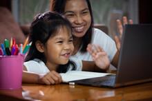 Asian Child Girl Using Noteboo...