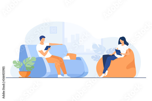 Young couple reading books in living room isolated flat vector illustration. Cartoon happy woman and man resting on sofa and armchair. Home, holiday and relaxation concept