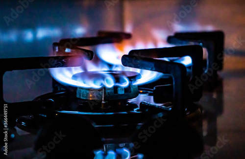 Gas stove - burning blue flames on gas cooker Fototapet