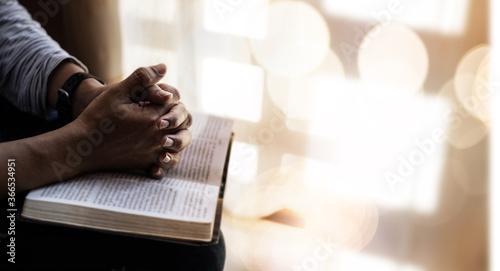 Cuadros en Lienzo Close up of man hands praying on bible.