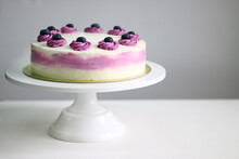 Blueberry Cream Cake Close Up On Light Background. White And Purple Cake