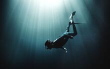Underwater View Of Diver Weari...