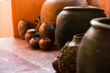 Traditional Pottery, A Group Of Jars And Gourds On A Tiled Floor.