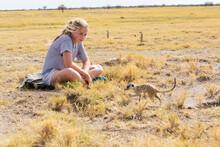 12 Year Old Girl Looking At Meerkats, Kalahari Desert, Makgadikgadi Salt Pans, Botswana