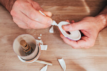 Male Hands Glue Together Fragments Of Ceramic Dishes - Superglue For Repairing Hard Materials
