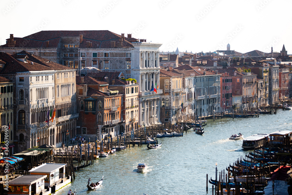 Old Colorful Buildings line the Grand Canal in Venice Italy with Gondola boats and docks in summer part 2