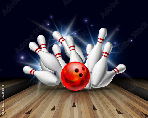 Fotografia Red Bowling Ball crashing into the pins on bowling alley line