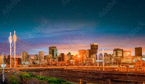 Nelson Mandela Bridge at night with Johannesburg city skyline in Gauteng South Africa