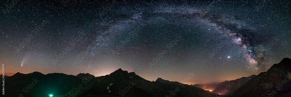 Fototapeta Milky Way arc and stars in night sky over the Alps. Outstanding Comet Neowise glowing at the horizon on the left. Panoramic view, astro photography, stargazing.