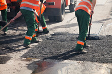 Workers On Asphalting Paver Ma...