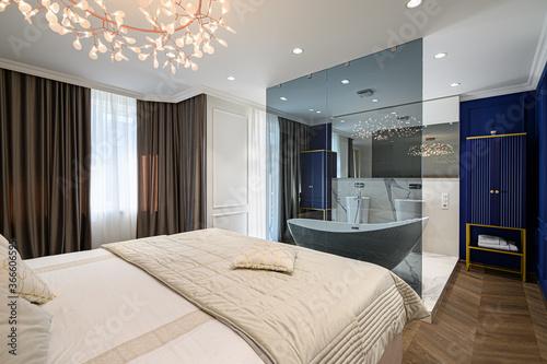 Billede på lærred Big comfortable double bed in elegant classic bedroom