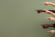Hands Of Caucasian Women And African-American Man Showing Something On Color Background. Racism Concept