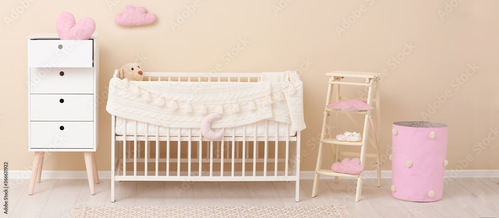 Fototapeta Baby room interior with comfortable crib. Banner design