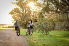 Children Riding Bikes On Remote Country Lane