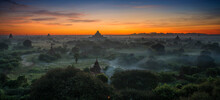 Pagoda Landscape Of Bagan In Misty Morning, Pagoda Landscape Under A Warm Sunrise In The Plain Of Bagan