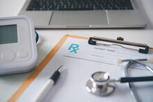 Rx Blank With Stethoscope Resting On A Doctor's Desk