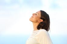 Adult Woman Breathing Fresh Ai...