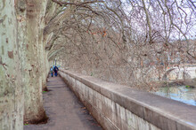 Tiber Riverside Alley In Rome . Pair Walking Together