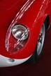 50s red car headlight close-up.