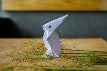 Creative Flat Lay Out. White Rabbit Paper Origami On Wooden Background With Copy Space Concept