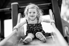 Cute Toddler Girl Playing On S...