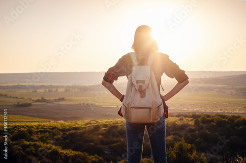 Obraz na plátne Asian woman traveler on the viewpoint over sunset time