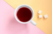 Red Hibiscus Tea In A White Cu...