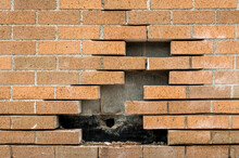 Bricks Missing From A Brick Wa...