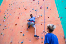 A Boy Climbs The Wall, A Coach...