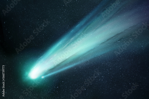 Fotografiet Comet Neowise passing the sun and releasing gases creating a tail and coma
