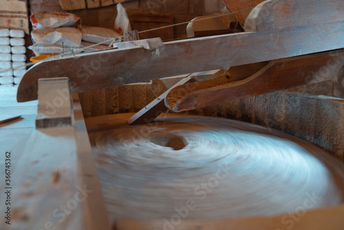 Valokuva The ancient old stone grain mill gristmill grinding wheat or grains into flour u