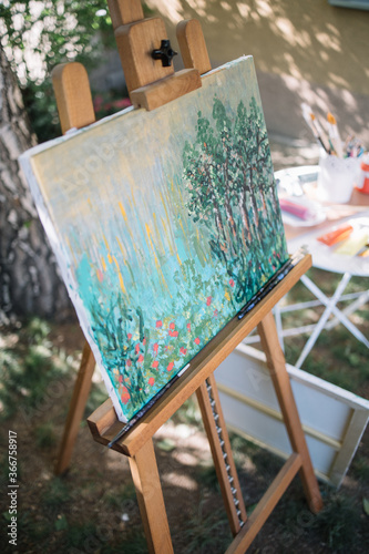 Canvas Watercolor drawing on canvas stand placed in garden