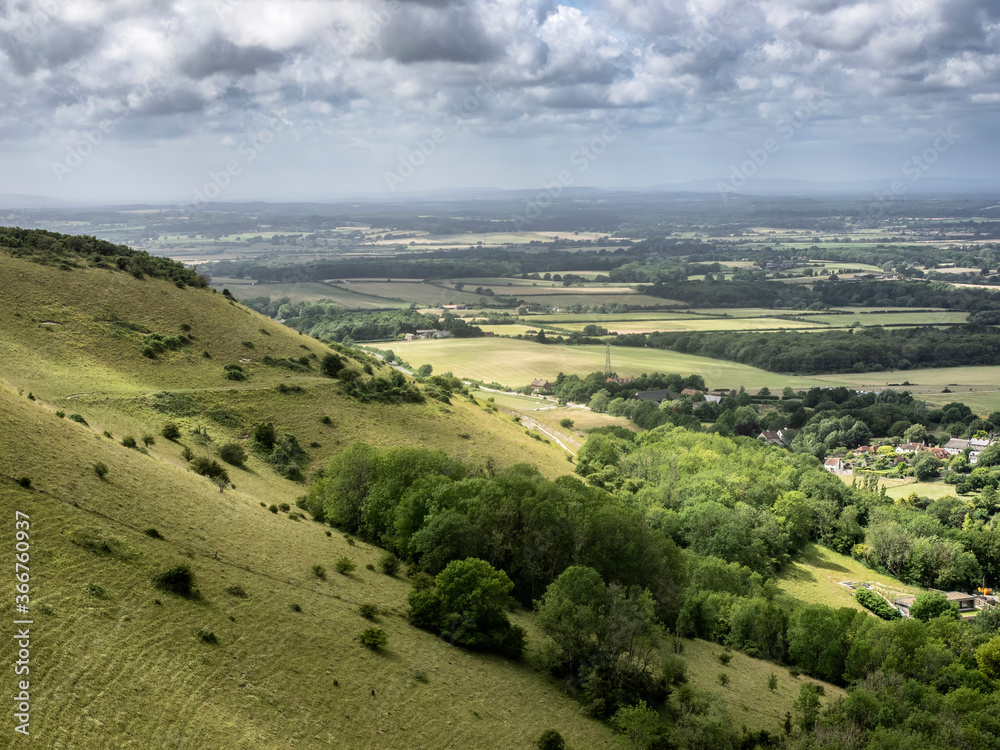 Fototapeta tunning vibrant landscape image of English countryside on lovely Summer afternoon overlooking rolling hills and country villages
