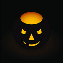 A Simple Jack O Lantern Candle Holder On A Black Background.