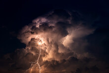Dark Cloud At  Night With Thunder Bolt. Heavy Storm Bringing Thunder, Lightnings And Rain In Summer.