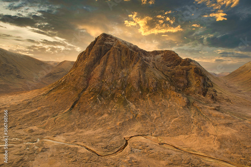 view of the Buachaille Etive Mor mountain with Dramatic clouds and rays of light in Glencoe, Highlands, Scotland Canvas Print