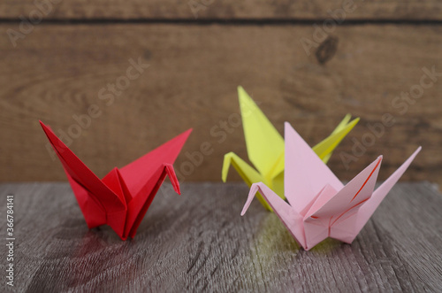 Fotografie, Obraz Origami cranes on wooden