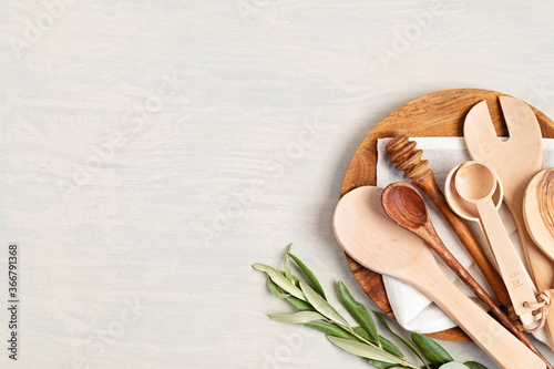 Fototapeta Traditional wooden kitchen utensils abd kitchenware mock up. Home cooking, recipe book template. Top view, copy space obraz
