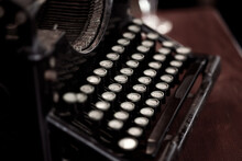 Retro Typewriter With Round Keys Placed On Wooden Table In Old Fashioned Office