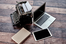 From Above Of Retro Typewriter Placed On Table With Agenda And Modern Netbook And Tablet