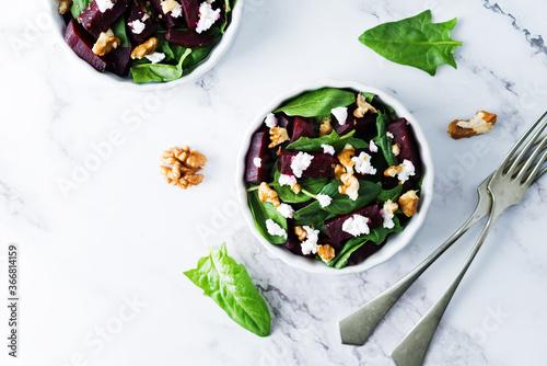 Fototapeta Spinach beet goat cheese walnuts salad obraz