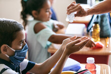School: Teacher Gives Hand San...