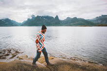 Man Tourist Walking On Beach Traveling In Norway Active Vacations Outdoor Healthy Lifestyle Explore Lofoten Islands