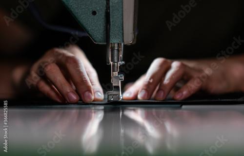Fotografia, Obraz hands with a sewing machine.