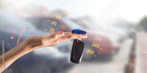 Fototapeta hand with electronic car key or remote obraz