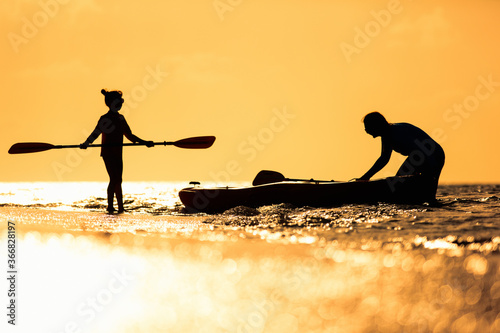 Family kayaking at sunset Canvas Print